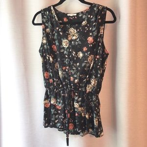 Sleeveless blouse with white rose floral print